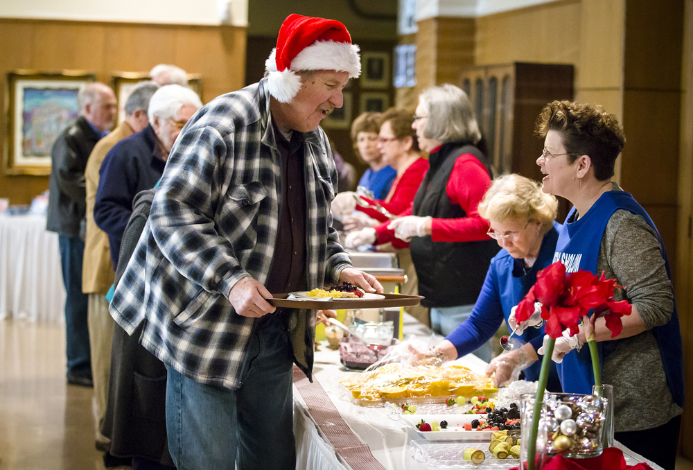Blaine Pool, left, is offered an assortment of fresh fruits from volunteer Marcia Blitstein, right, during the 12th annual Holiday Interfaith Breakfast at Temple B'rith Sholom, Friday, Dec. 25, 2015, in Springfield, Ill. The money raised from this year's breakfast will be donated to the Senior Services of Central Illinois. Justin L. Fowler/The State Journal-Register