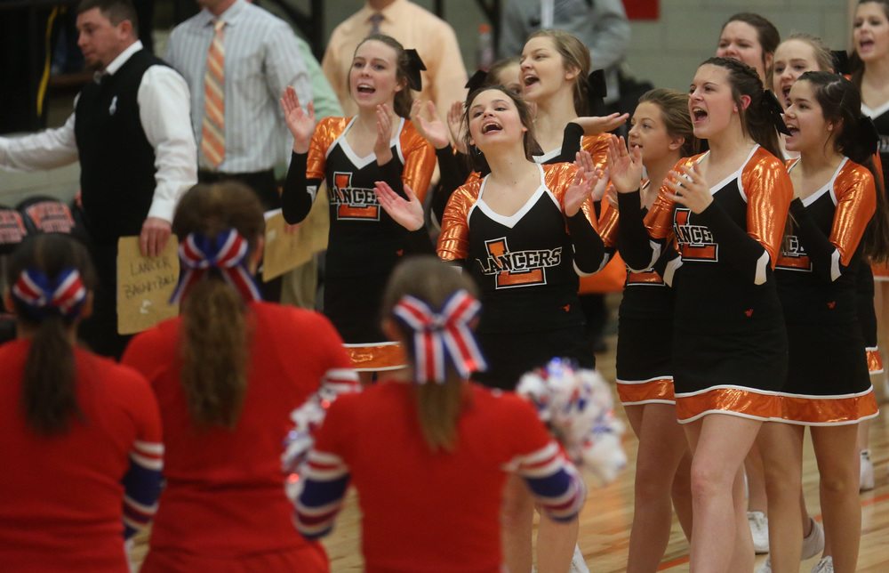 Lancer cheerleaders celebrate at the end of the game. David Spencer/The State Journal-Register