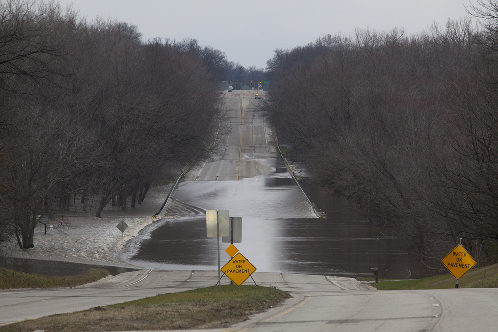 Peoria Road is closed where the Sangamon River has washed over it at Riverside Park Wednesday, Dec. 30, 2015. Rich Saal/The State Journal-Register