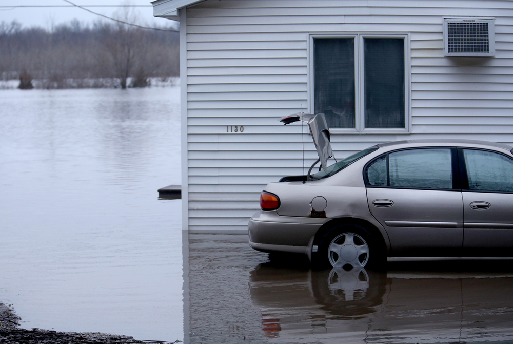 An abandoned car in the 1100 block of Springfield St. is seen in Kincaid on Wednesday, Dec. 30, 2015. In Kincaid, which sits near the South Fork of the Sangamon River, floodwaters closed a section of Illinois 104, with a section of homes in South Kincaid along Springfield St. surrounded by water cut off. Volunteers using atv's ferried supplies into the area for homes that still had power not affected by the flooding.  David Spencer/The State Journal-Register