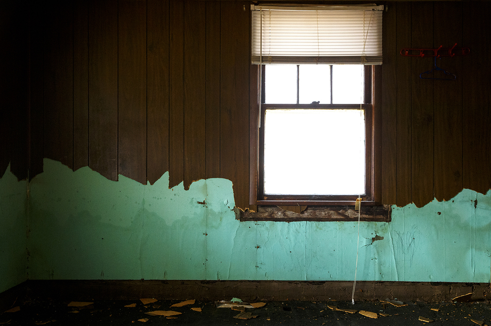 The high water mark of flood waters is visible on aqua blue paint that was revealed after wet paneling was torn down in a flood-damaged Kincaid home Sunday, Jan. 3, 2015. Ted Schurter/The State Journal-Register