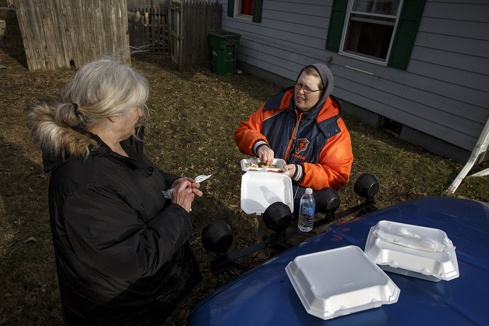 Sharon Stivers, left, and her daughter Cathy pause to eat food provided by the Red Cross as they take a break from the clean-up of Sharon's flood-damaged Kincaid home Sunday, Jan. 3, 2015. Ted Schurter/The State Journal-Register