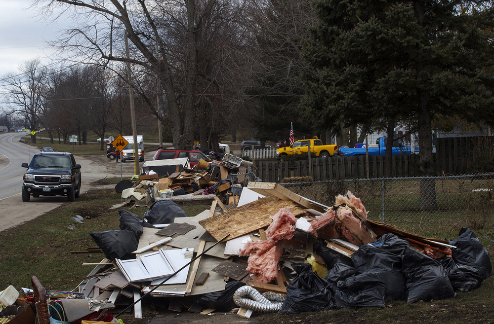 Debris from flood-damaged homes is piled up on the sidewalk along Illinois Route 104 in Kincaid where nearly 40 homes were damaged by a flood that followed three days of rain last week. Ted Schurter/The State Journal-Register