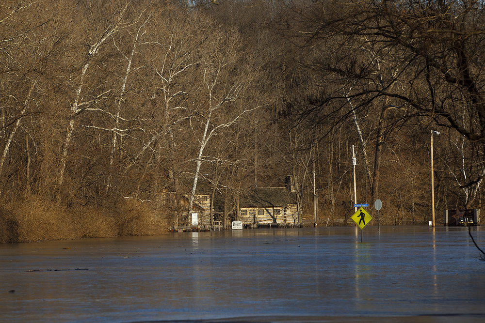 Flood waters cover Illinois Route 97 and the entrance to New Salem State Historic Site Saturday, January 2, 2015. Ted Schurter/The State Journal-Register