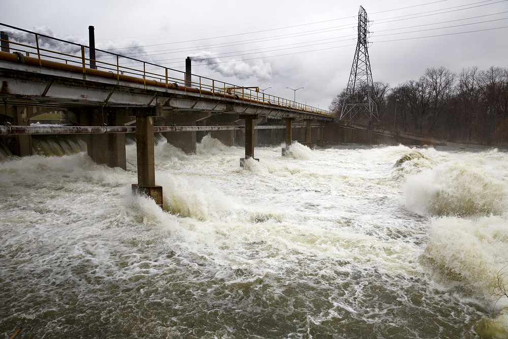 Water runs over Spaulding dam and into Sugar Creek after the gates were opened to lower the level of Lake Springfield Monday, Dec. 28, 2015. Rich Saal/The State Journal-Register