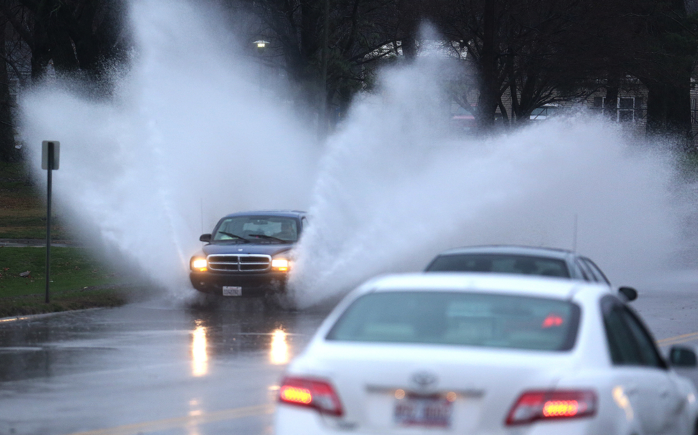 A motorist drives through water in the 2900 block of E. Clear Lake Ave. near Bergen Golf Course Monday, Dec. 28, 2015. David Spencer/The State Journal-Register