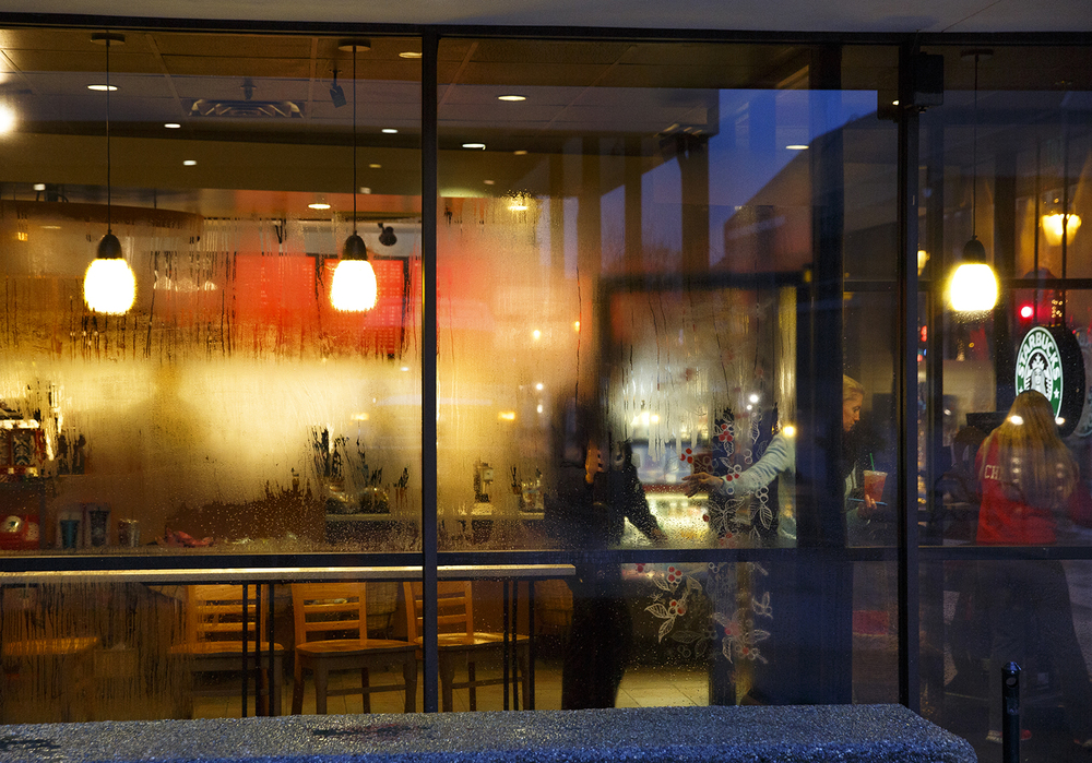Windows of the Starbucks coffee shop in the Hilton Springfield offer colorful relief on a dreary afternoon in Springfield Monday, Dec. 28, 2015. Rich Saal/The State Journal-Register