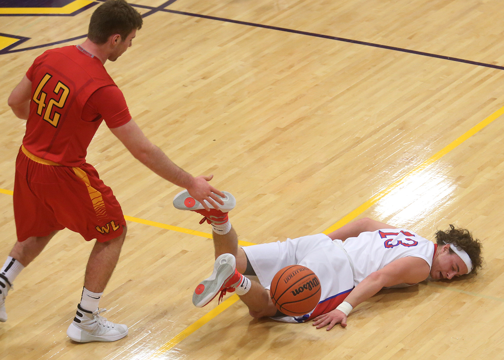 Pleasant Plains' Cole Greer hit the deck after a collision with Warrensburg-Latham's Garrett Shea during action at the Williamsville Holiday Boys Basketball Tournament Wednesday, Dec. 30, 2015. David Spencer/The State Journal-Register�