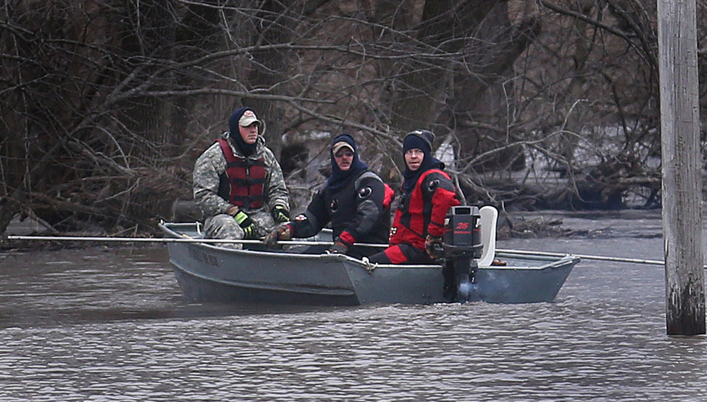 Taylorville Fire Department Dive and Rescue Team members from left to right Jeff Stoner, Mike Mann and Nick Hackney search for two missing Christian County men last seen around 10 p.m. Monday on Thursday, Dec. 31, 2015. The search was going on northeast of Kincaid along the South Fork of the Sangamon River at E. 1700 North Rd. The missing men are Brandon Mann and Devan Everett, both 18. David Spencer/The State Journal-Register