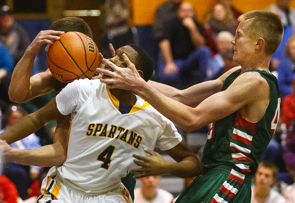 Lincoln's David Biggs grips Southeast's Raykwon Green's face as he tries to grab a rebound at Southeast High School Tuesday, Jan. 5, 2016. Ted Schurter/The State Journal-Register