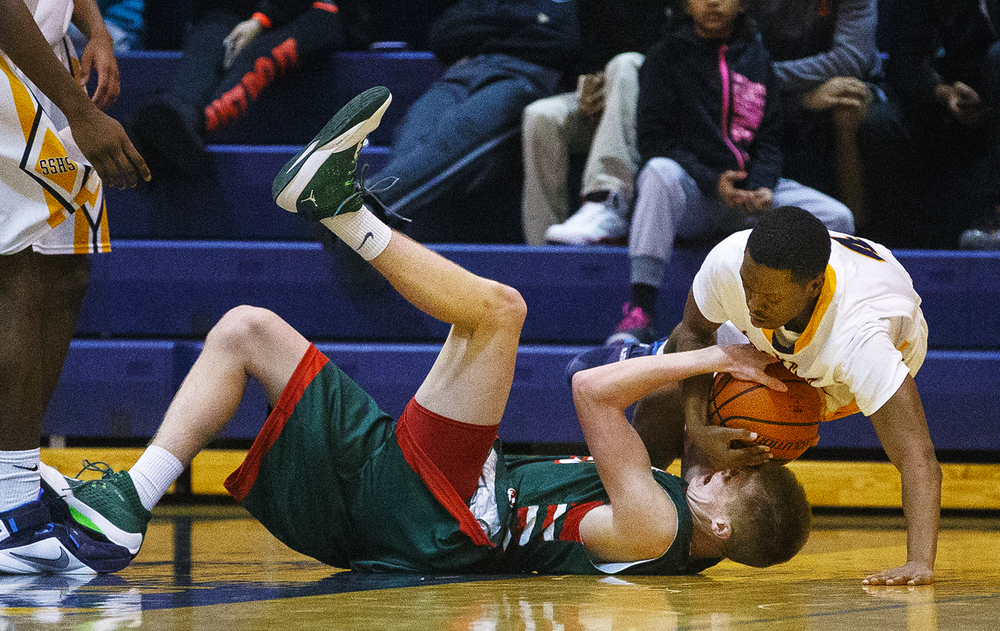 Lincoln's David Biggs and Southeast's Raykwon Green wrestle for a rebound at Southeast High School Tuesday, Jan. 5, 2016. Ted Schurter/The State Journal-Register