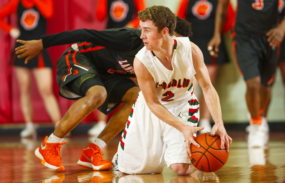 Lincoln's Garrett Aeilts scoops a loose ball up off the floor against Lanphier at Lincoln High School Friday, Jan. 8, 2016. Ted Schurter/The State Journal-Register