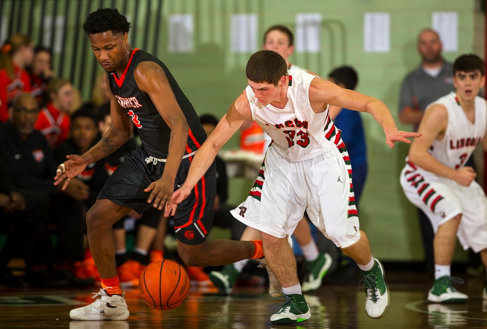 Lanphier's Derrick King and Lincoln's Nolan Hullinger race for a loose ball at Lincoln High School Friday, Jan. 8, 2016. Ted Schurter/The State Journal-Register