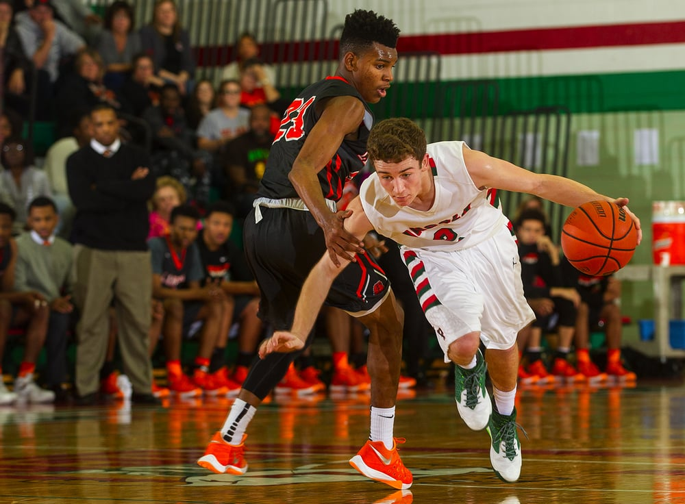 Lincoln's Garrett Aeilts drives past Lanphier's Aundrae Williams at Lincoln High School Friday, Jan. 8, 2016. Ted Schurter/The State Journal-Register