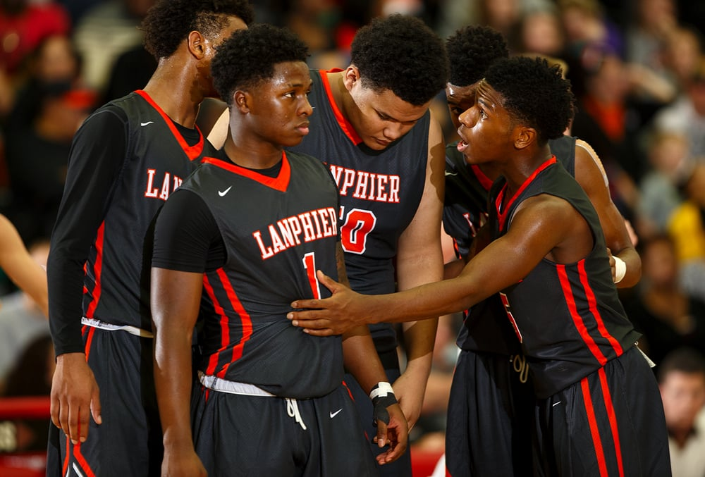 Lanphier's Xavier Bishop encourages his teammates as they take the court after Lincoln rallied in the second half at Lincoln High School Friday, Jan. 8, 2016. Ted Schurter/The State Journal-Register