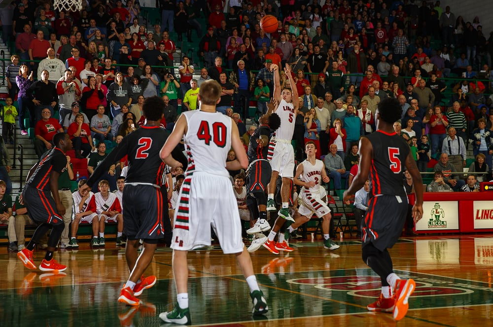 The crowd stands as Lincoln's Aaron Hopp fires a potentially game-winning shot against Lincoln with less than two seconds left Friday, Jan. 8, 2016. The shot missed. Ted Schurter/The State Journal-Register