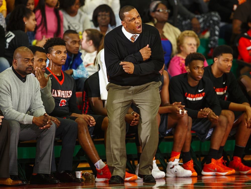 Lanphier head coach Blake Turner reacts to his team's first half performance at Lincoln High School Friday, Jan. 8, 2016. Ted Schurter/The State Journal-Register