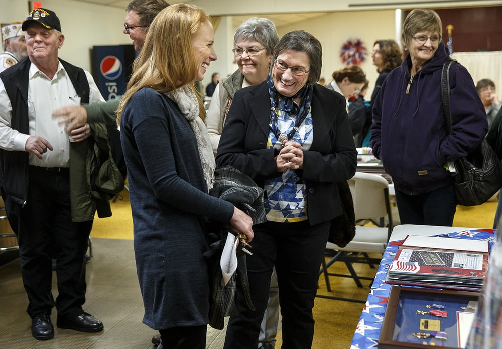 Shirley Gross visits with guests during a celebration of life for Gross' son,  Marine Staff Sgt. Roger Gross who died in November  nearly ten years after being injured in an IED explosion near Baghdad, Iraq, at the Veterans of Foreign Wars Post 755 Saturday, Jan. 9, 2016. Ted Schurter/The State Journal-Register
