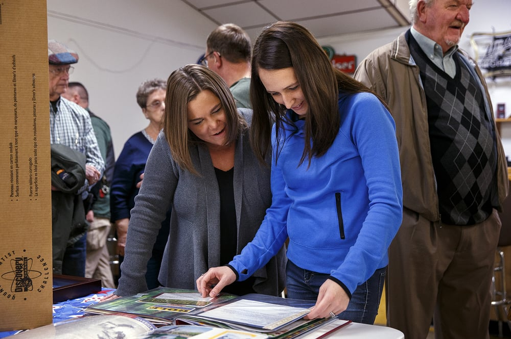 Marcie Kuchar, left, and Jessica Fuess look through an album of photos and memorabilia of Marine Staff Sgt. Roger Gross who died in November  nearly ten years after being injured in an IED explosion near Baghdad, Iraq, during a Celebration of Life at the Veterans of Foreign Wars Post 755 Saturday, Jan. 9, 2016. Kuchar was Gross' classmate at Riverton High School. Ted Schurter/The State Journal-Register