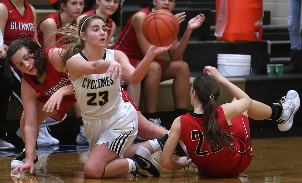Cyclones player Kenzie Tree looks to pass late in the game while defended by Titans players Makenzie Bray at left and Ciara Lahr. David Spencer/The State Journal Register