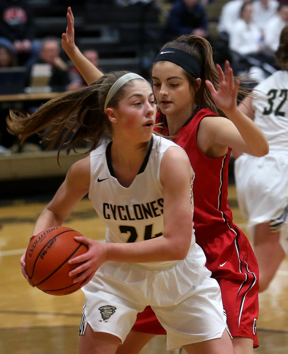 Cyclones player Anna Lowis looks to get the ball around Titans defender Lexie Iacono during first half play. David Spencer/The State Journal Register