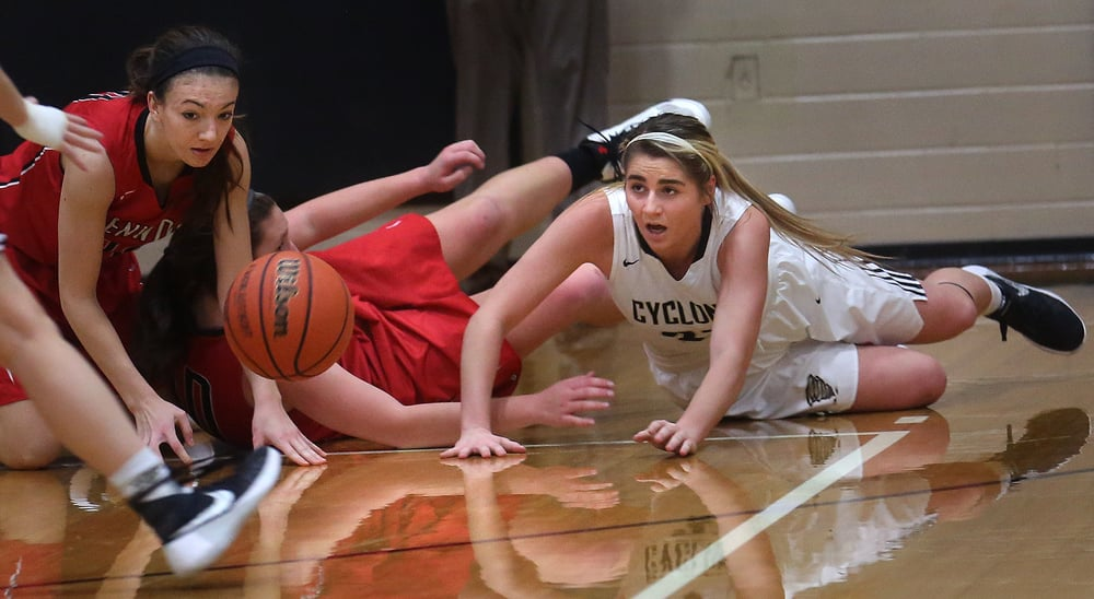 A loose ball in first half action was the result of a collision between Titan players Ciara Lahr at left and Makenzie Bray as well as Cyclones player Kenzie Trees at right. David Spencer/The State Journal Register