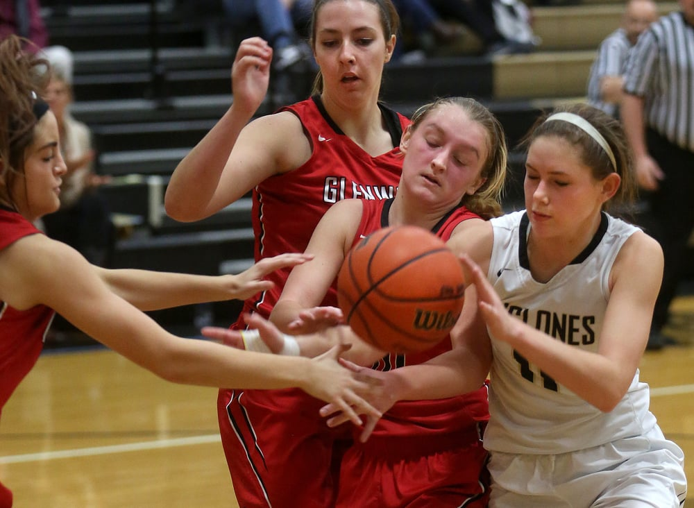 Trying to get ahold of the ball late in the game are Titan players Abbey Deverman at center and Kaitlyn Brown in back as well as Cyclones player Catie Costa. David Spencer/The State Journal Register
