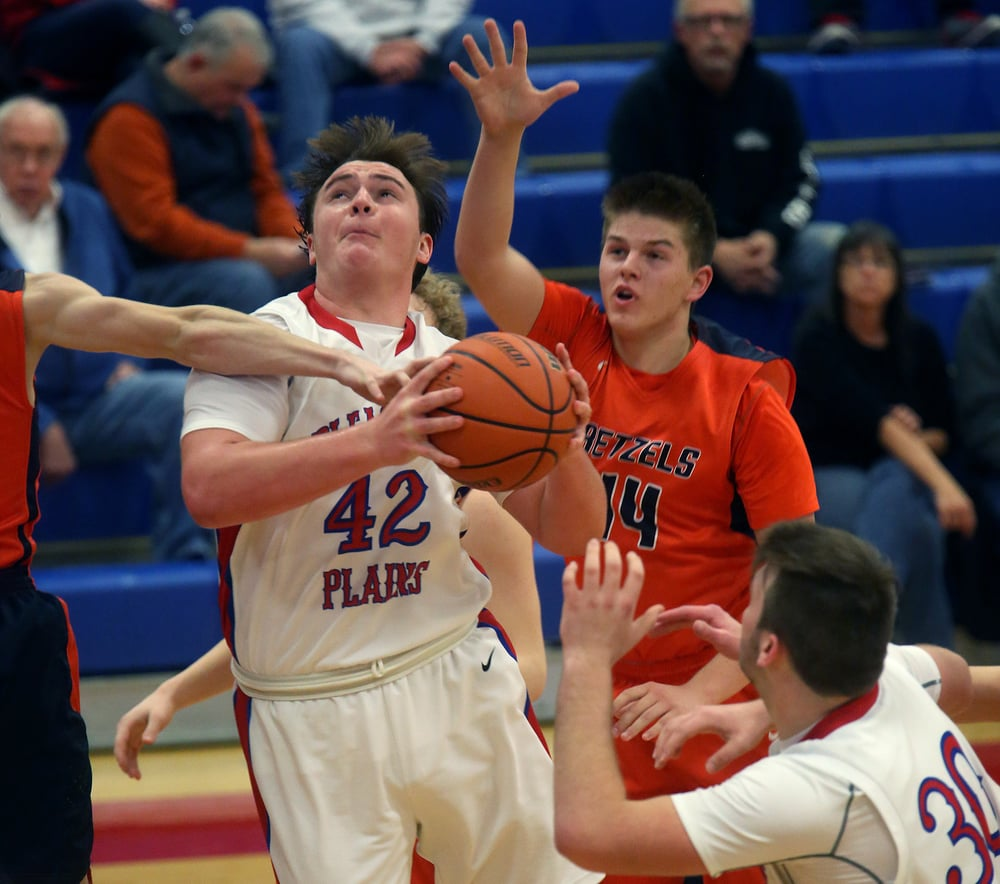 Pleasant Plains player Nik Clemens prepares to put up two points in the second half. David Spencer/The State Journal Register