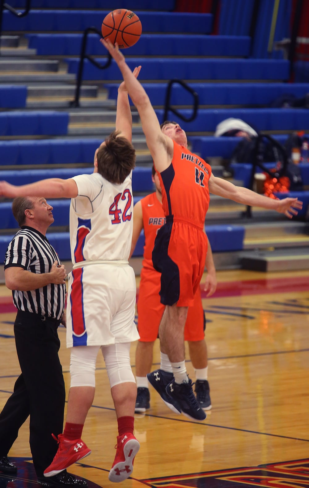 New Berlin's Josh Fuchs won the tipoff against Pleasant Plains player Nik Clemens. David Spencer/The State Journal Register