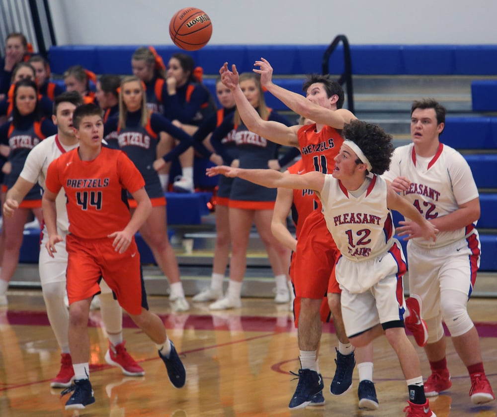 New Berlin's Josh Fuchs got this pass past a defending Daulton Nibbe of Pleasant Plains during the first half. David Spencer/The State Journal Register