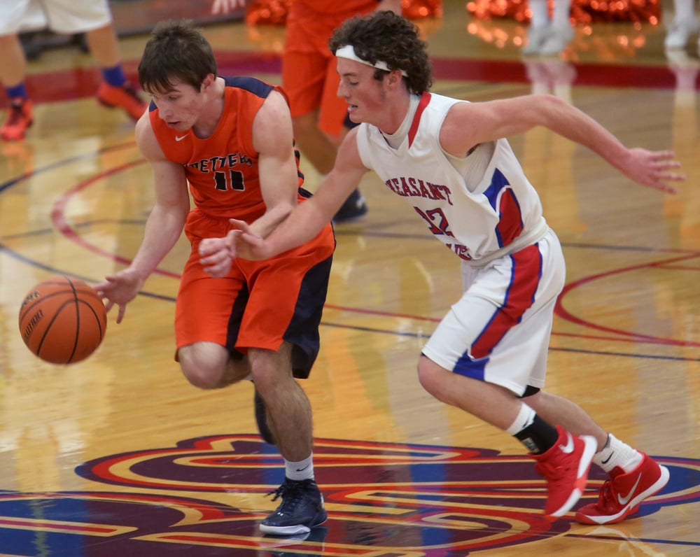 New Berlin's Josh Fuchs tries to keep possession while heading downcourt against Pleasant Plains defender Daulton Nibbe during the first half. David Spencer/The State Journal Register