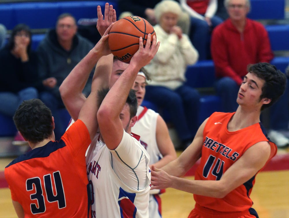 Pleasant Plains player Austin Finley pulls down a rebound during the first half. David Spencer/The State Journal Register