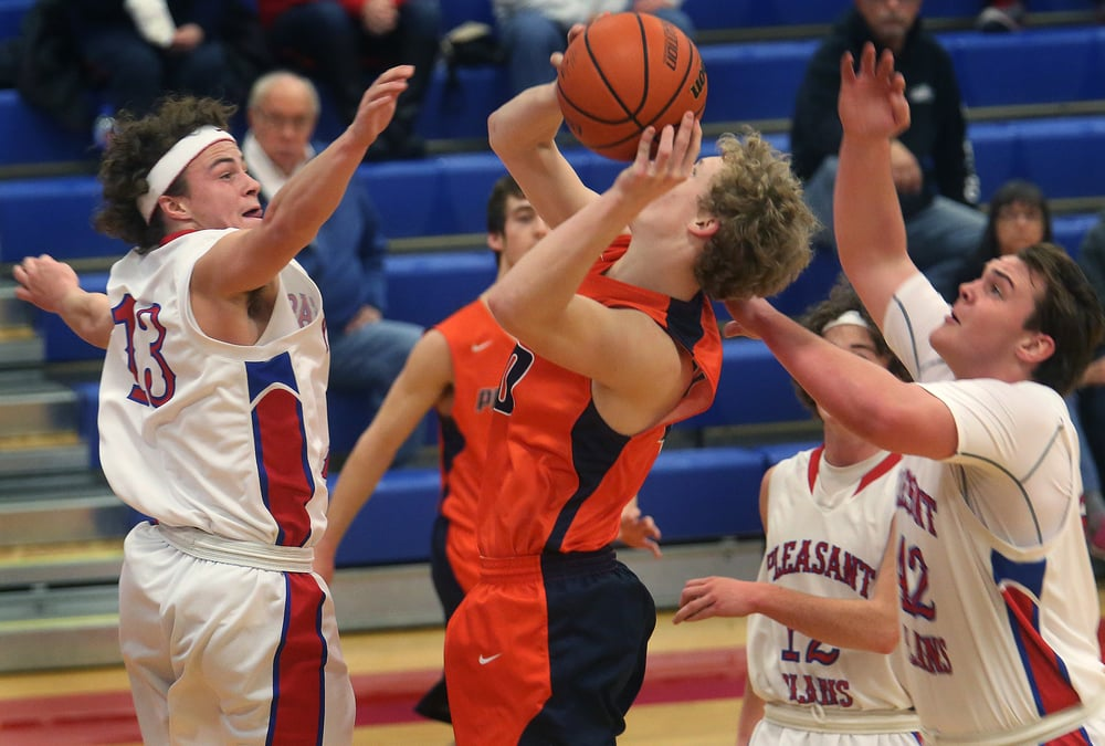 Pleasant Plains player Cole Greer at left defends while New Berlin player Ben Nichols tries to put up a shot. David Spencer/The State Journal Register