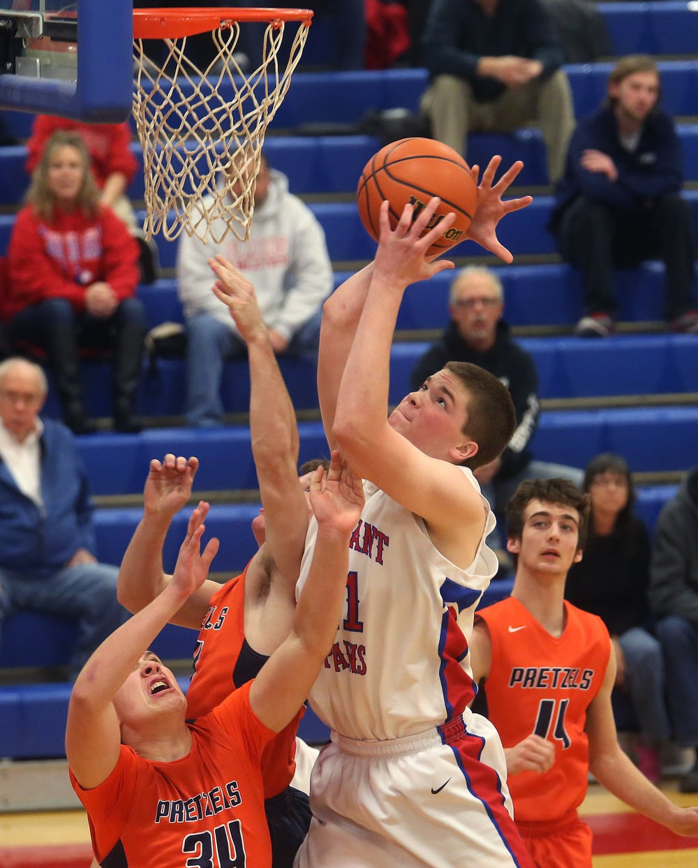 Pleasant Plains player Kaleb Wolters grabs a rebound. David Spencer/The State Journal Register