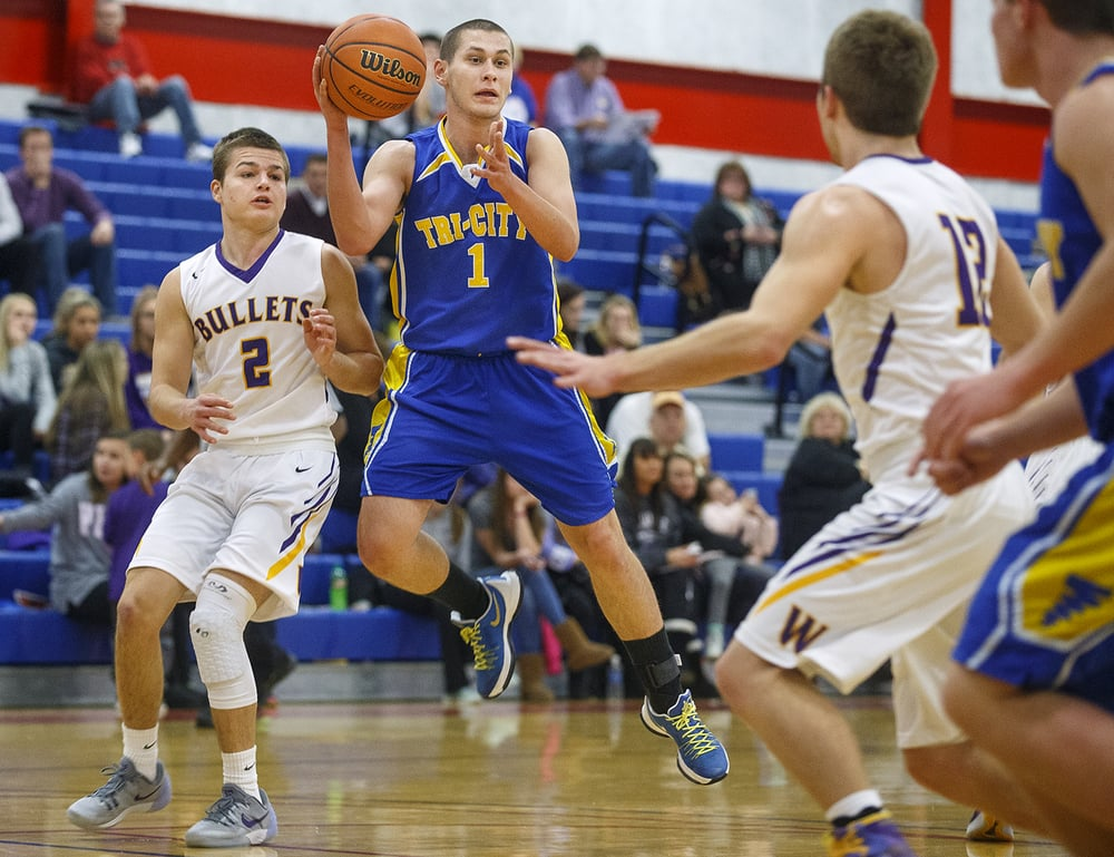 Tri-City's Steven Price flies past two Williamsville defenders during the County Tournament at Lincoln Land Community College Tuesday, Jan. 12, 2016. Ted Schurter/The State Journal-Register