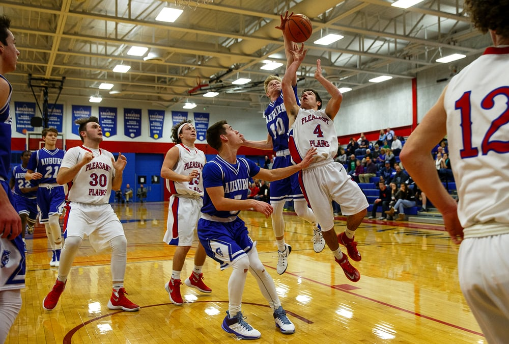 Auburn's Tristan Waver blocks a shot by Pleasant Plains' Aden Sachs during the semifinals of the Sangamon County Boys Basketball Tournament Wednesday, Jan. 13, 2016. Ted Schurter/The State Journal-Register