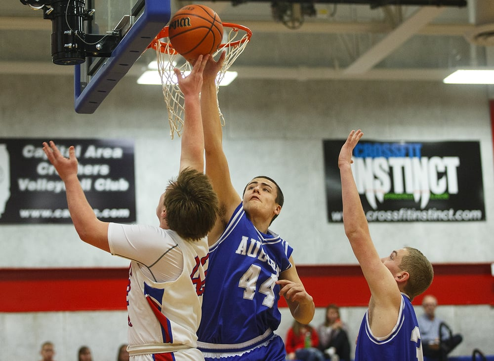 Auburn's Connor Berola swats away a Pleasant Plains shot during the semifinals of the Sangamon County Boys Basketball Tournament Wednesday, Jan. 13, 2016. Ted Schurter/The State Journal-Register