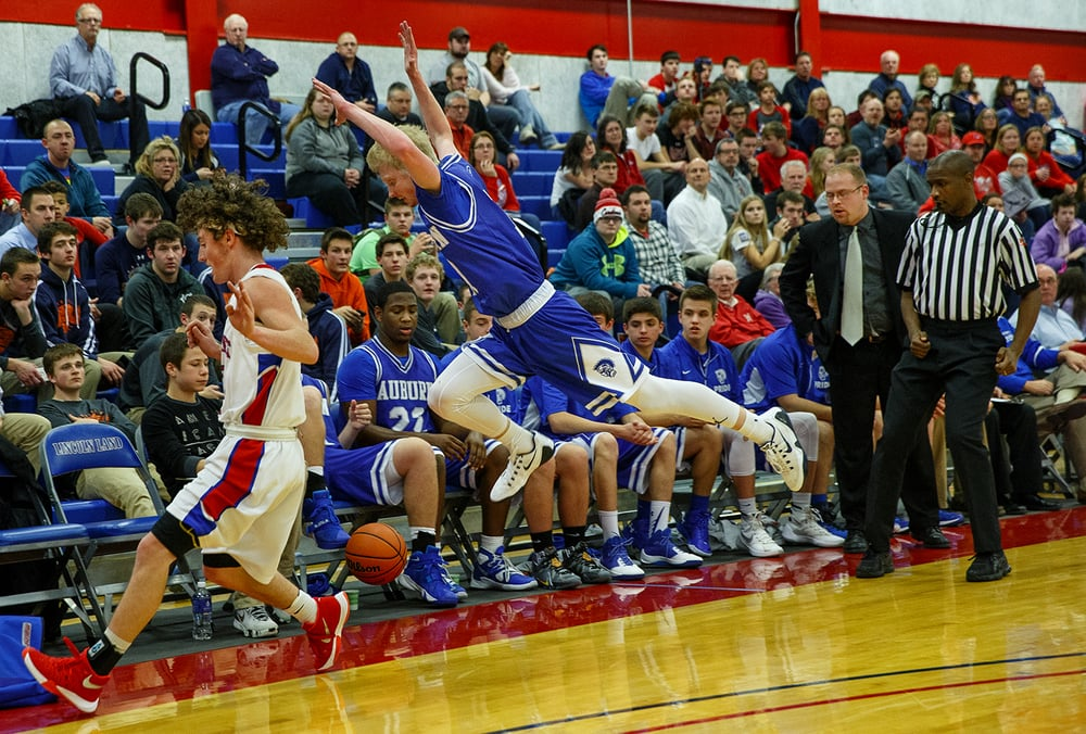 Auburn's Tristan Waver flies out of bounds chasing a loose ball during the semifinals of the Sangamon County Boys Basketball Tournament Wednesday, Jan. 13, 2016. Ted Schurter/The State Journal-Register