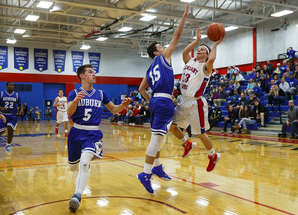 Auburn's Ben Johnson blocks a shot by Pleasant Plains' Cole Greer during the semifinals of the Sangamon County Boys Basketball Tournament Wednesday, Jan. 13, 2016. Ted Schurter/The State Journal-Register