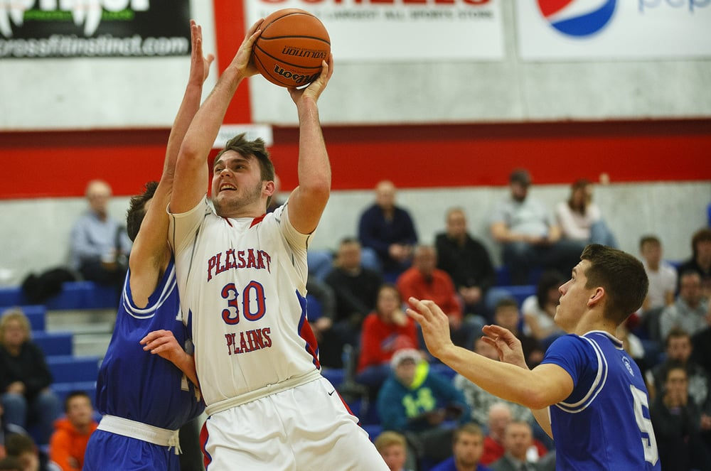 Pleasant Plains' Austin Finley plows to the hoop against Auburn during the semifinals of the Sangamon County Boys Basketball Tournament Wednesday, Jan. 13, 2016. Ted Schurter/The State Journal-Register