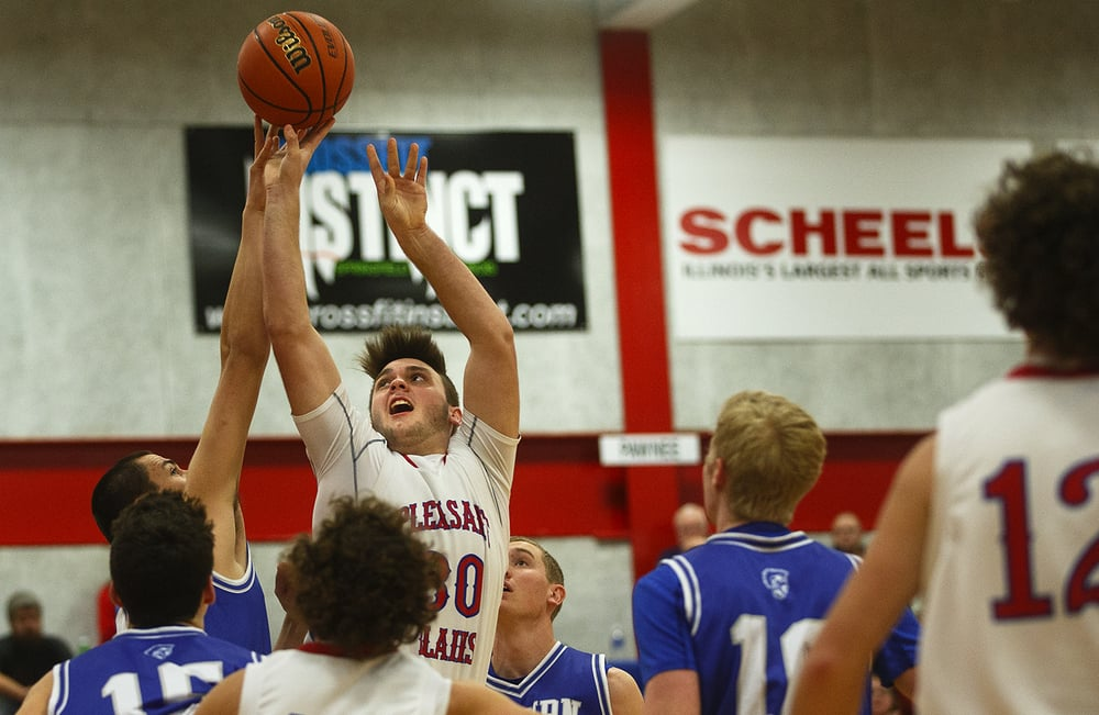 Pleasant Plains' Austin Finley stretches to get his shot above an Auburn defender during the semifinals of the Sangamon County Boys Basketball Tournament Wednesday, Jan. 13, 2016. Ted Schurter/The State Journal-Register