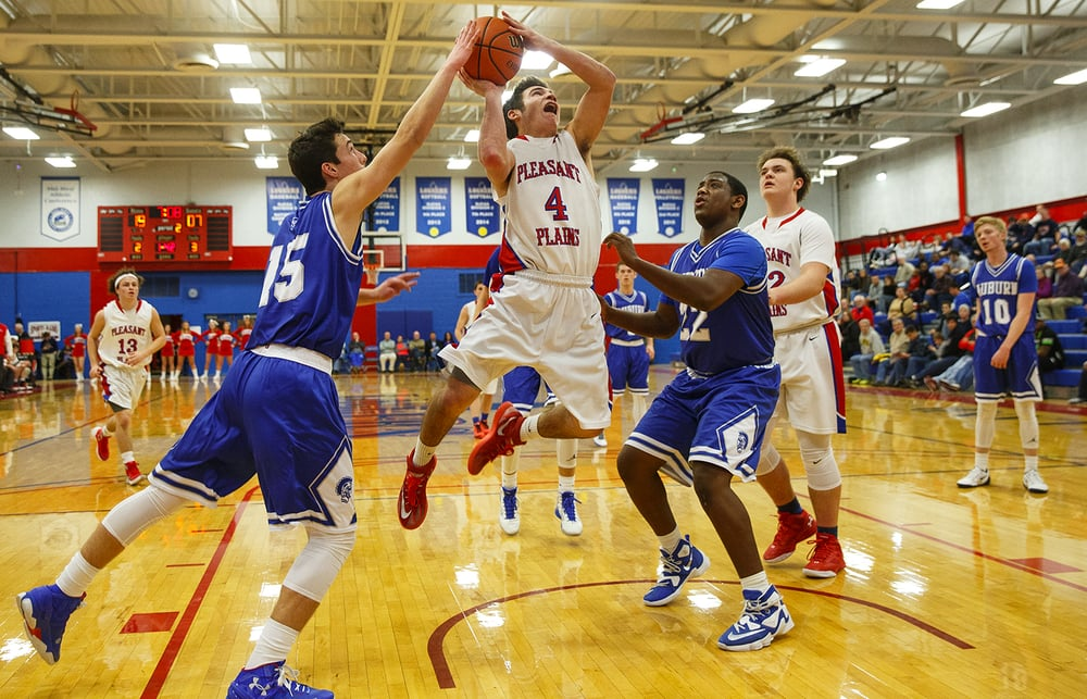 Auburn's Ben Johnson gets a hand on Pleasant Plains' Aden Sachs' shot during the semifinals of the Sangamon County Boys Basketball Tournament Wednesday, Jan. 13, 2016. Ted Schurter/The State Journal-Register