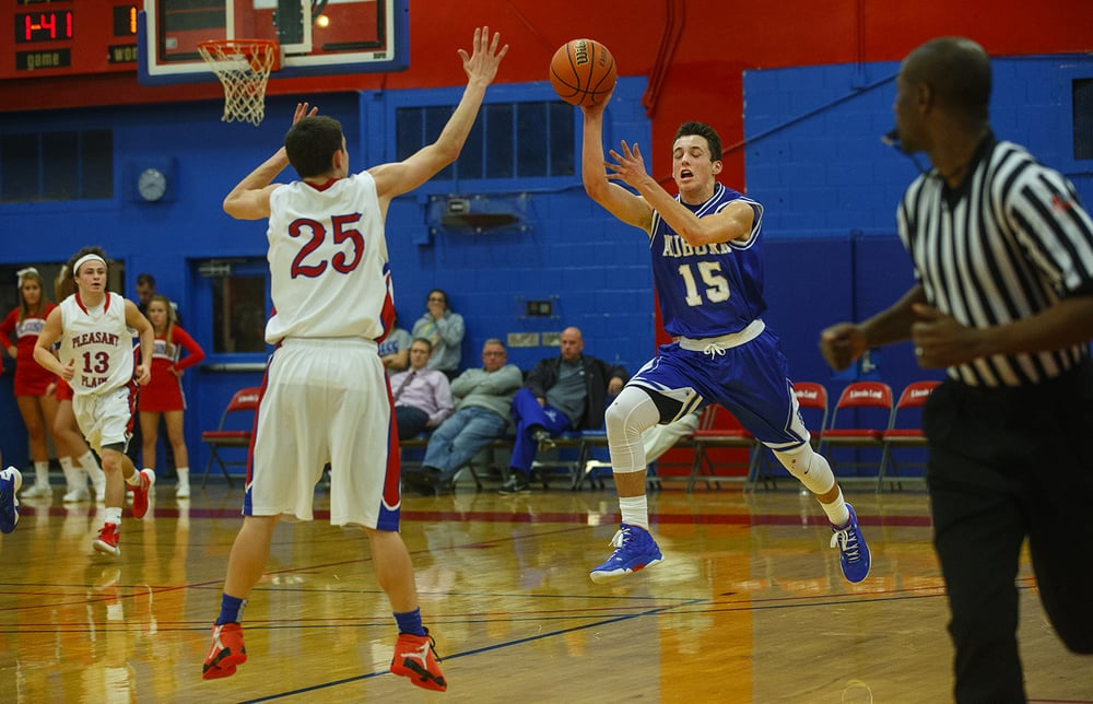 Auburn's Ben Johnson fires a pass upcourt against Pleasant Plains during the semifinals of the Sangamon County Boys Basketball Tournament Wednesday, Jan. 13, 2016. Ted Schurter/The State Journal-Register