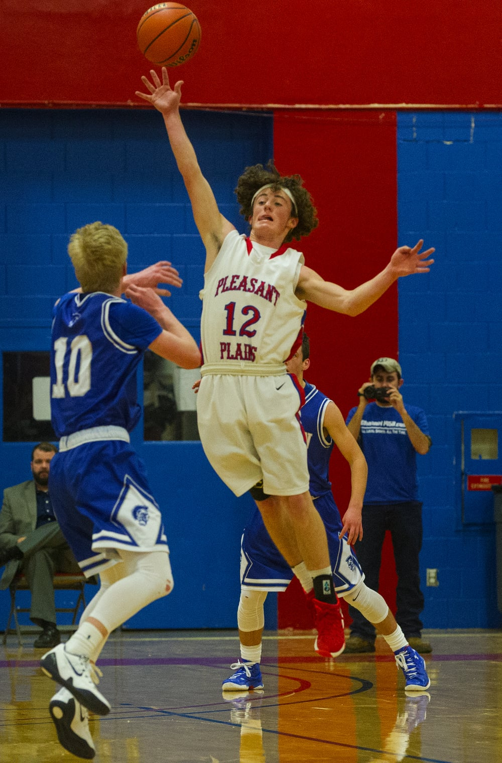 Pleasant Plains' Daulton Nibbe leaps to reach an Auburn pass from Tristan Waver during the semifinals of the Sangamon County Boys Basketball Tournament Wednesday, Jan. 13, 2016. Ted Schurter/The State Journal-Register