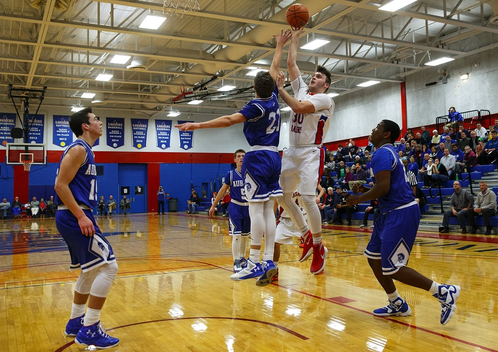 Pleasant Plains' Austin Finley puts in two of his 18 points against Auburn during the semifinals of the Sangamon County Boys Basketball Tournament Wednesday, Jan. 13, 2016. Ted Schurter/The State Journal-Register