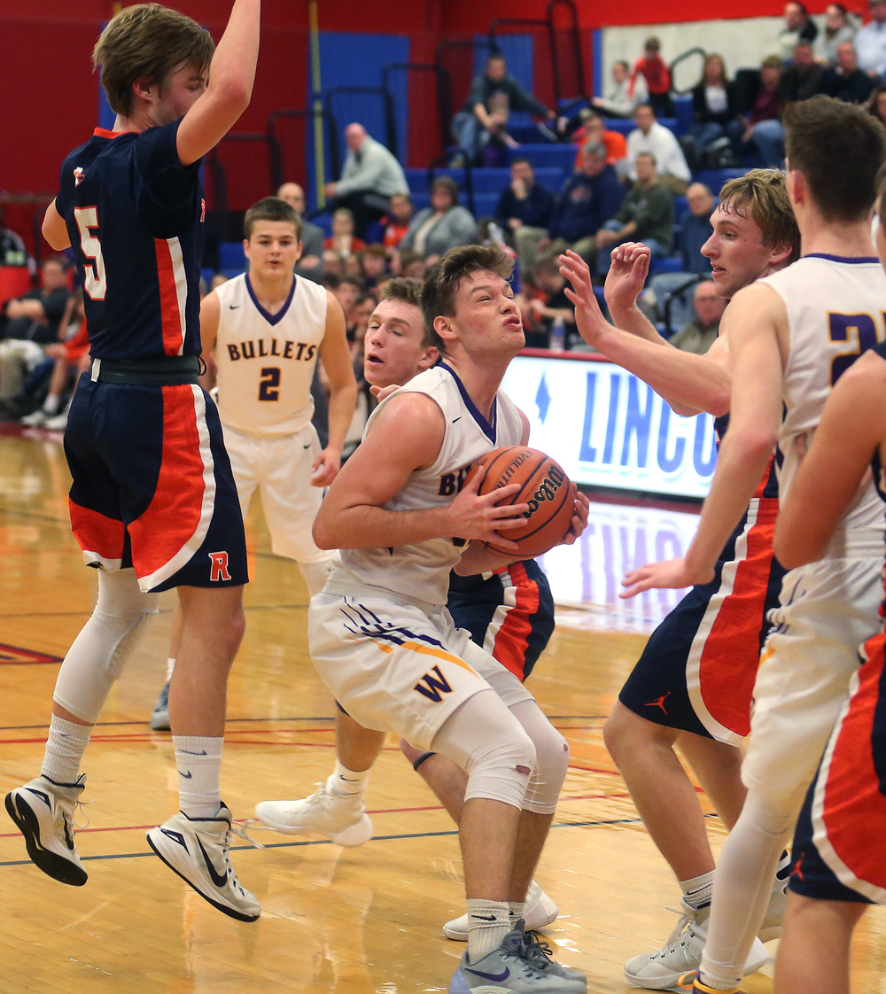 Williamsville player Jacob Sexton tries to get a shot off in the second half while defended by Rochester players Dalton Handlin at left and Matt McClintock to right of Sexton. David Spencer/The State Journal Register