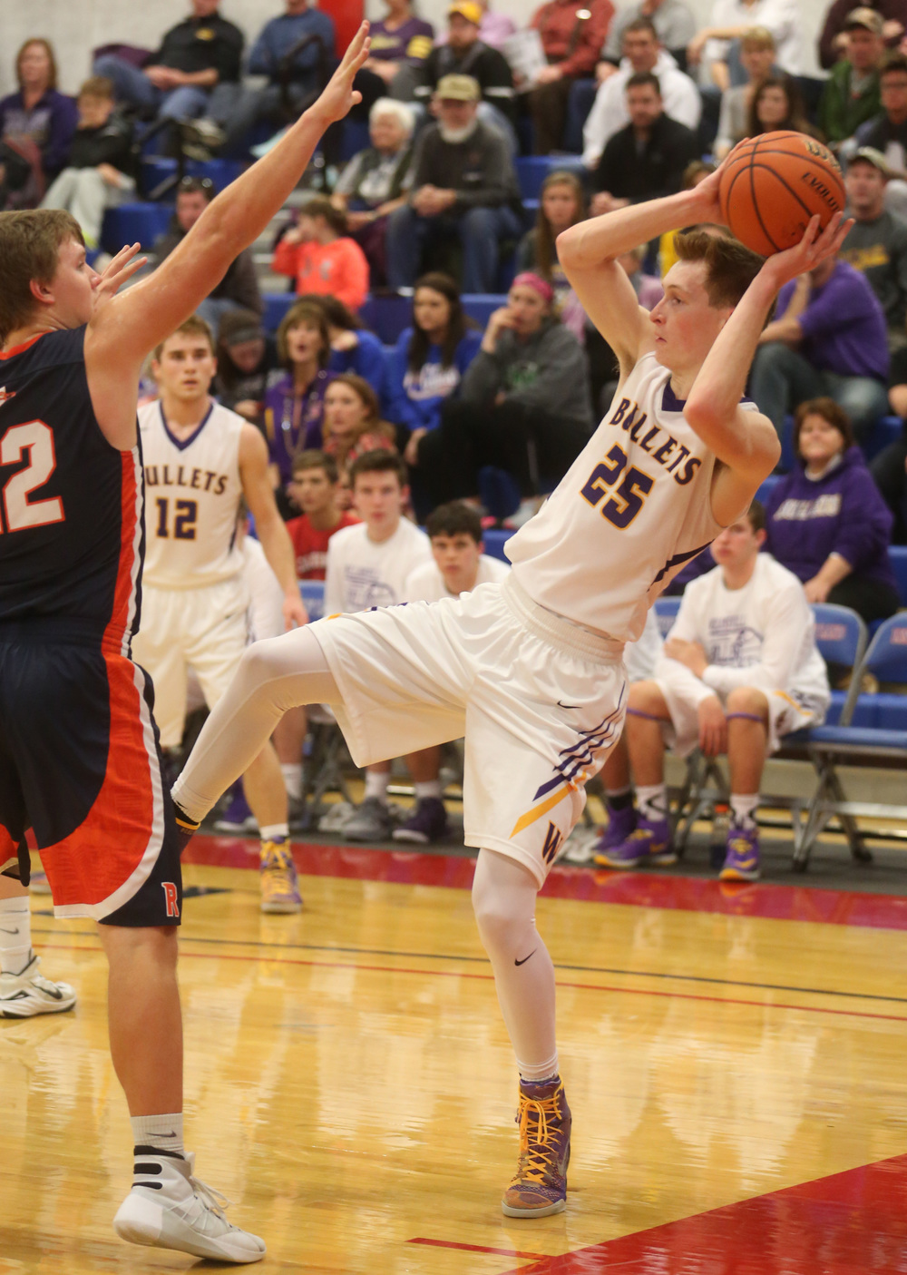 Williamsville player Harrison Creswell balances on one foot while looking to pass in the second half. David Spencer/The State Journal Register