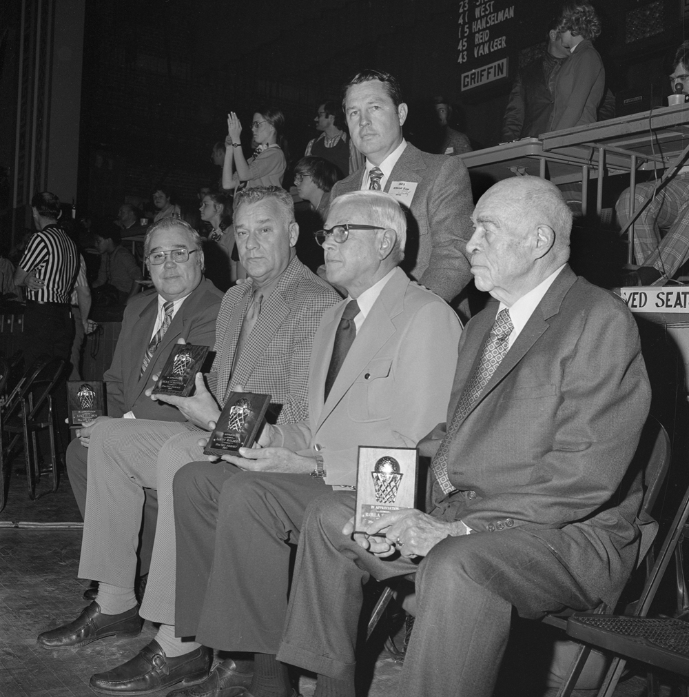 Springfield High School basketball coaches honored at the Boy's City Basketball Tournament at the Illinois State Armory, Jan 27, 1973. From left, Luke Gleason, Cathedral; Herb Scheffler, SHS; Jim Belz, Griffin AD (standing), Leroy Halberg,  Feitshans;  Rolla Sorrels, Lanphier. Original coaches at the first city tourney in 1949. File/The State Journal-Register