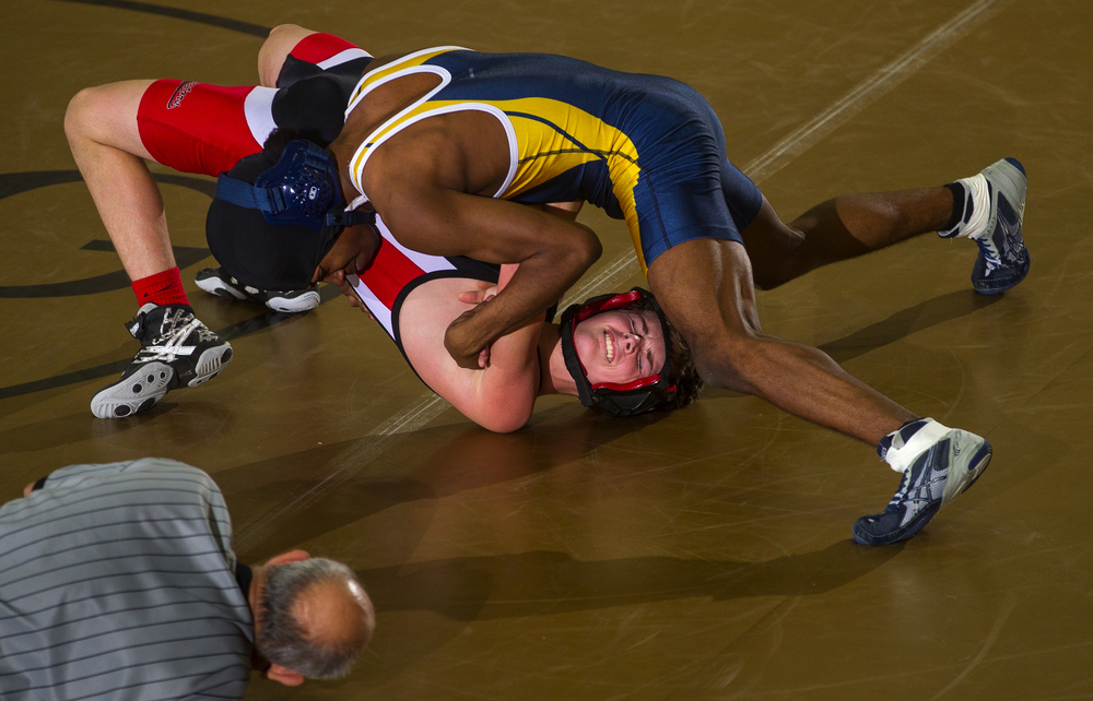 Southeast's Jerry Davenport controls Springfield's Jacquez Steward during the City Duals wrestling tournament at Jim Belz Gymnasium at Sacred-Heart Griffin Friday, Jan. 15, 2016. Ted Schurter/The State Journal-Register
