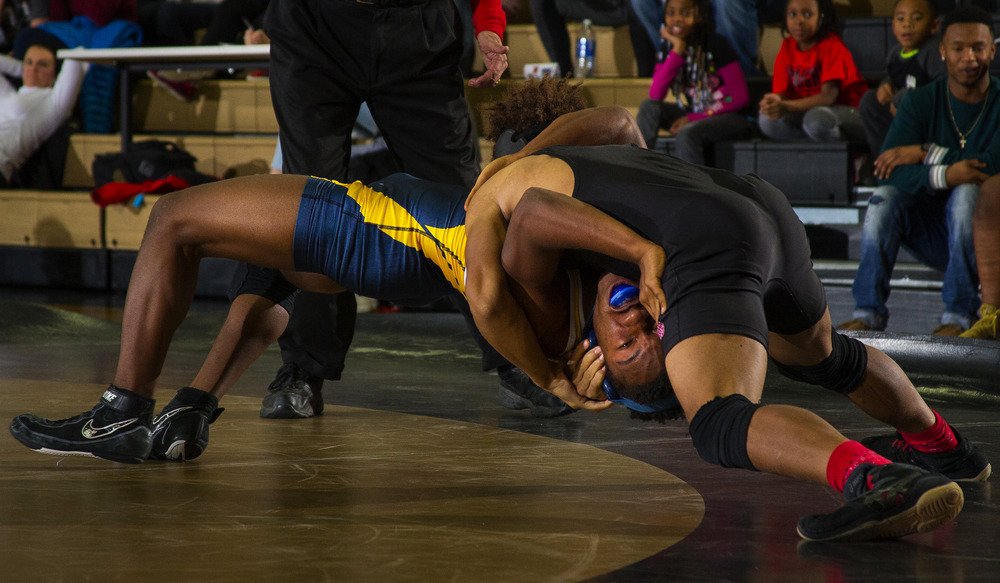 Springfield's Eugene Phillips tries to turn Southeast's Rashad Sampson in the 126 pound bout during the City Duals wrestling tournament at Jim Belz Gymnasium at Sacred-Heart Griffin Friday, Jan. 15, 2016. Ted Schurter/The State Journal-Register
